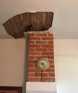 The impact on the ceiling and chimney